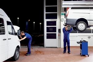 mechanics repairing vehicles