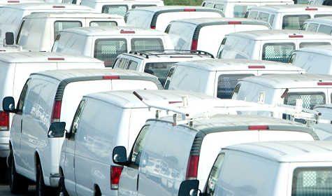 big fleet of white vans