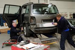 repairing car in garage