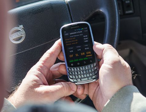 fleet driver with mobile phone in hand