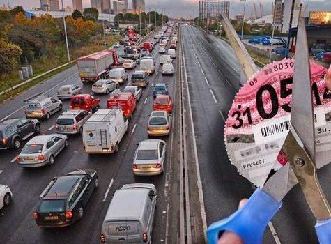 car tax disc cut up on motorway bridge