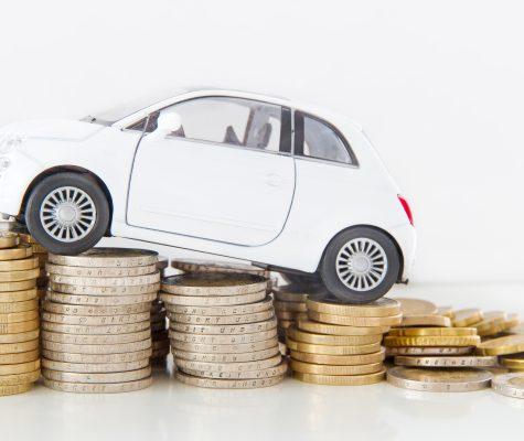 car on incline money coins