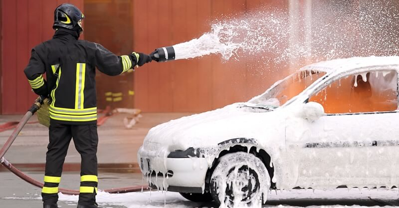 car fire extinguished by firefighter foam