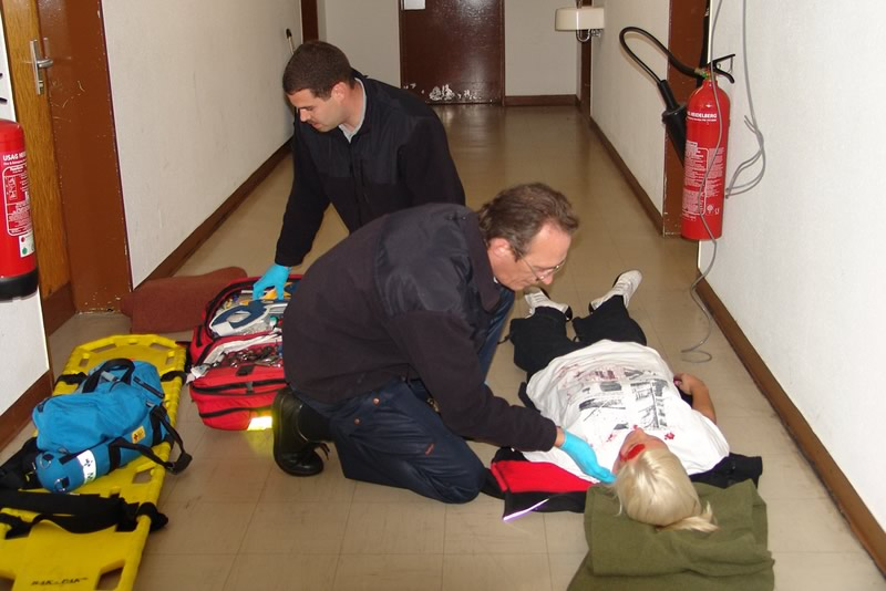 fire fighters practising first aid
